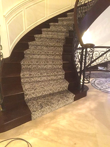custom carpet runner on curved stairs