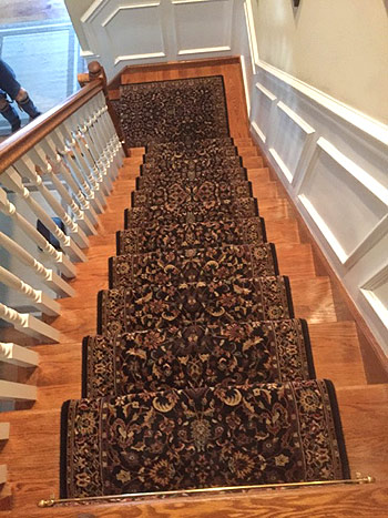 custom carpet runner installed on stairway